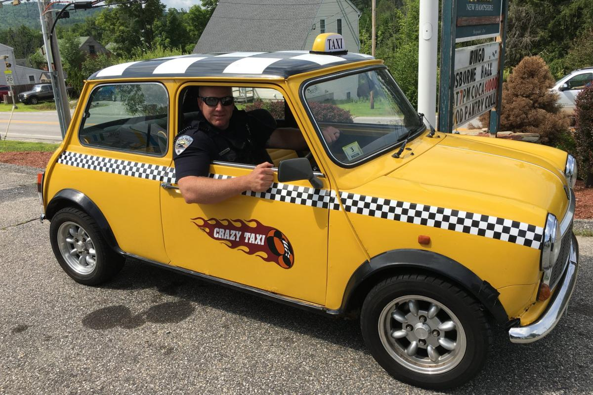 Officer in antique taxi